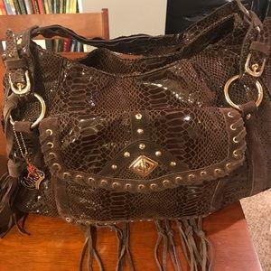 Carlos Santana purse